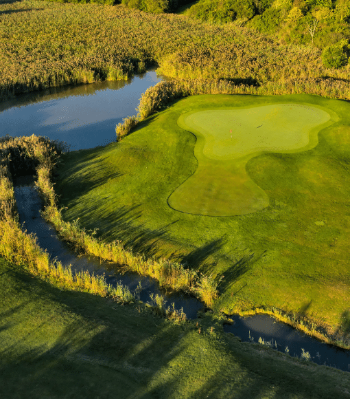 Aerial photo of hole 11 during sunset.